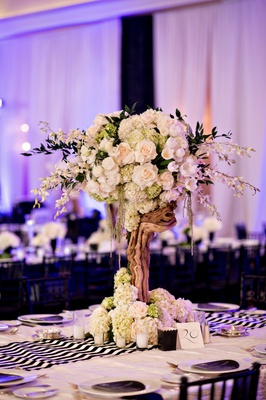 natural reception centerpiece mixed with modern décor purple lighting