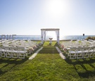 LOVE marquee sign and white, blush flowers on oceanfront lawn in Mexico at estate