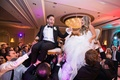 groom in lanvin, bride in reem acra during the horah at jewish wedding