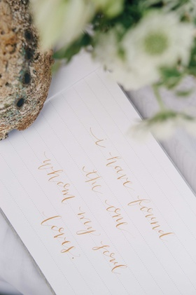 a guest book quote written in rose gold calligraphy