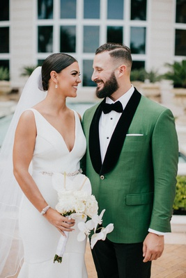 wedding portrait bride and groom miami florida v neck wedding dress green tuxedo jacket black lapels