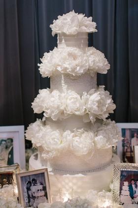 Bride and groom wedding photos of family around wedding cake made by same bakery as