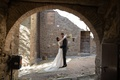 wedding portrait in tuscany with bride and groom framed in archway