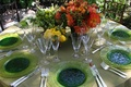 Wedding reception table with lime green charger plates