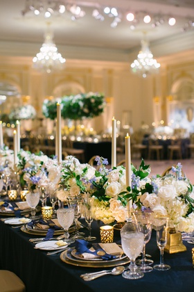 wedding reception long table low centerpiece flower runner alternative tall candles gold candles