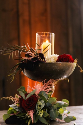 rustic décor at old-world or old-europe themed reception with candles roses and greenery