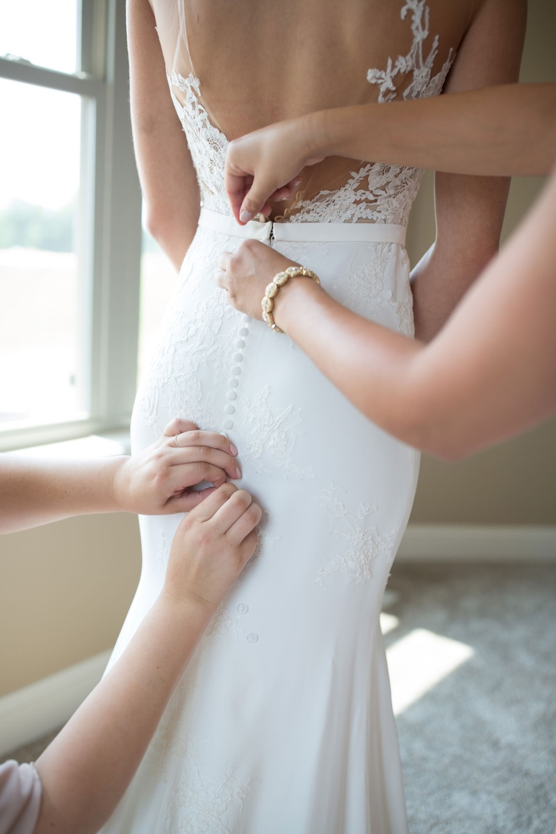 pronovias bridal gown with crepe skirt and lace appliqués, open back