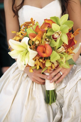 bouquet of green orchids, orange calla lilies and white lily
