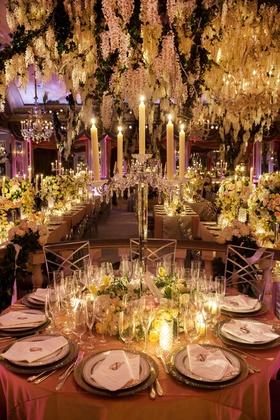Flickering taper candles atop crystal candelabra