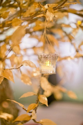Gold lea centerpiece with hanging votive and tea light