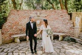 bride in bohemian wedding dress sleeves with bouquet groom in bow tie at houdini estate los angeles