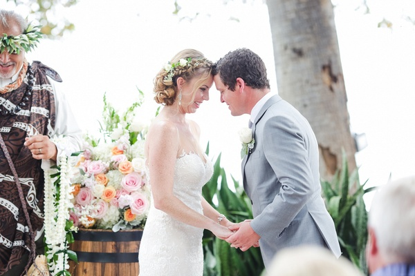 bride and groom touch foreheads before exchanging vows at Maui Hawaii outdoor wedding