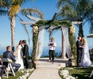 two brides, two grooms, double wedding, sisters at Malibu wedding ceremony