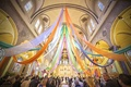 Colorful Chicago church wedding ceremony with orange, green, purple, and blue fabric