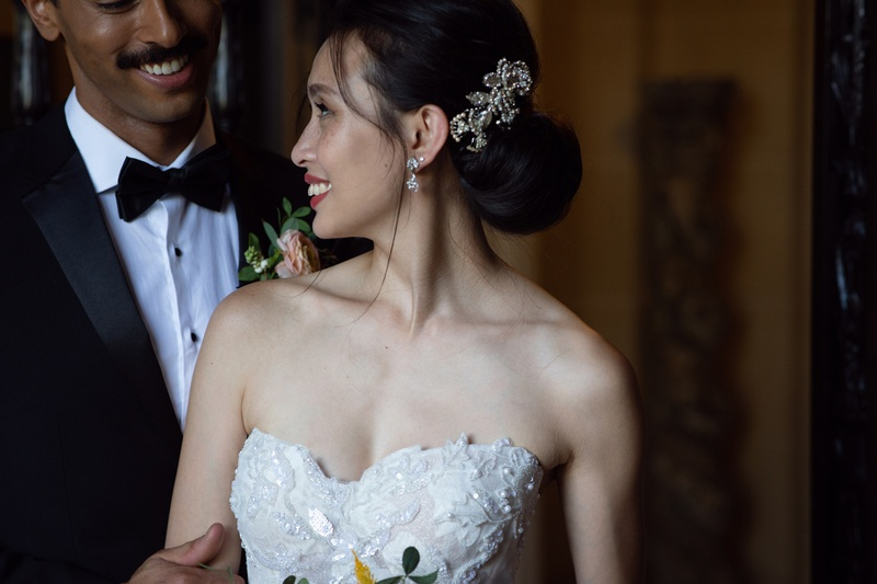 bride with low updo and jeweled clip on the side