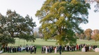 guests mingling at outdoor cocktail hour held before jewish wedding