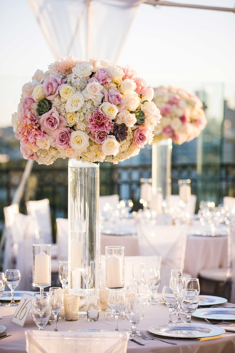 clear glass vase with pink ivory flowers wedding flower arrangements Tall wedding flower arrangement with white rose hydrangea pink rose dahlia and