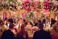 Wedding reception at The Plaza Hotel head table family tall pink white centerpieces greenery