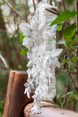 Lacy lingerie with clear beads hanging on branch
