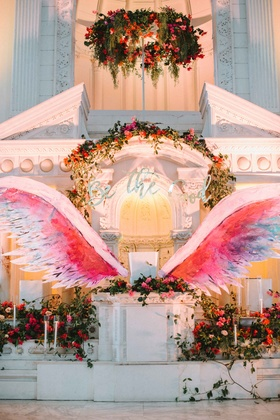 be the good sign altar wings bold pink purple blue red wedding ceremony altar
