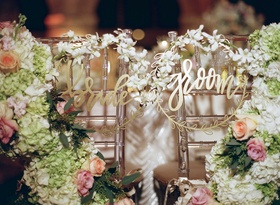 Laurel leaf circle bride and groom modern calligraphy chair signs lucite chairs flowers with orchids