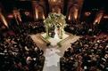 Jewish wedding with chuppah in center