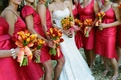 Bride and bridesmaids carry vibrant nosegays