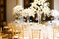 centerpieces of white flowers and hanging tea lights