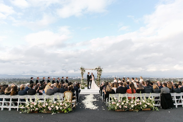 wedding ceremony overlooking los angeles california rustic wedding ceremony greenery pink flowers