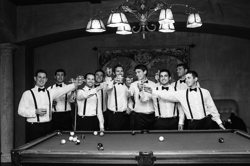 Black and white photo of groom and groomsmen at pool table
