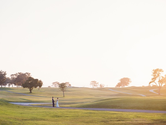 bride and groom on golf course at the lodge at torrey pines in san diego la jolla area destination