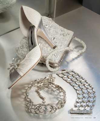 Silver snake open-toe d'orsay with rhinestone floral ornament by Carmen Marc Valco, $569. Beaded met