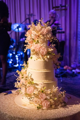 six-tier sylvia weinstock cake with cascading sugar flowers
