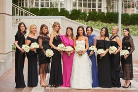 Bride in strapless wedding dress with maids of honor in pink and blue dresses black dresses choice