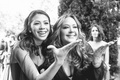 black and white photo of wedding guests leah remini and cheryl burke family member