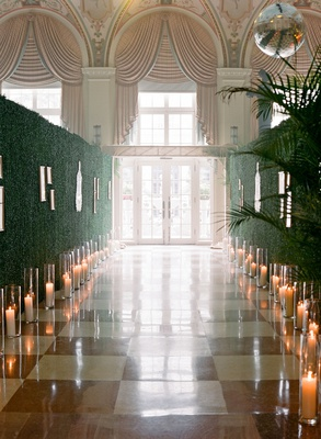 wedding reception entrance checkered flooring hedge wall candles photos long hall the breakers