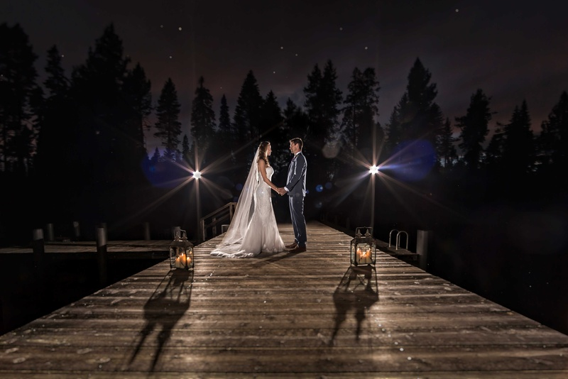 Couple on dock night dusk small lights darkened background lake tahoe california photographed by sallee photography
