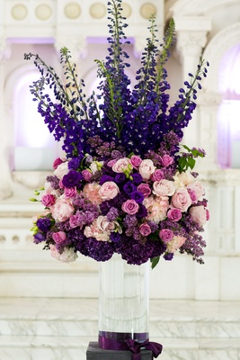 Clear vase topped with purple and pink flowers