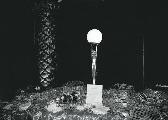 Black and white image of dessert table and trophy