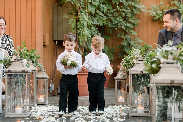 two ring bearers walking down the aisle, ring bearer moss pillow, ring bearer outfits ideas