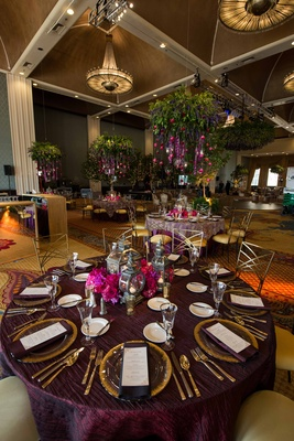 purple reception décor, cascading flowers, bold floral arrangement