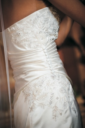 Vera Wang wedding gown with beading and embroidery, gathered by buttons on one side