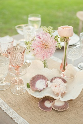 Shabby chic wedding with seashell and flower centerpieces