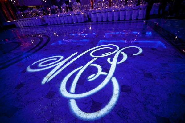 Wedding reception dance floor in blue with couple's monogram