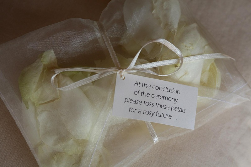 Ivory roses in sheer bag tied with ribbon