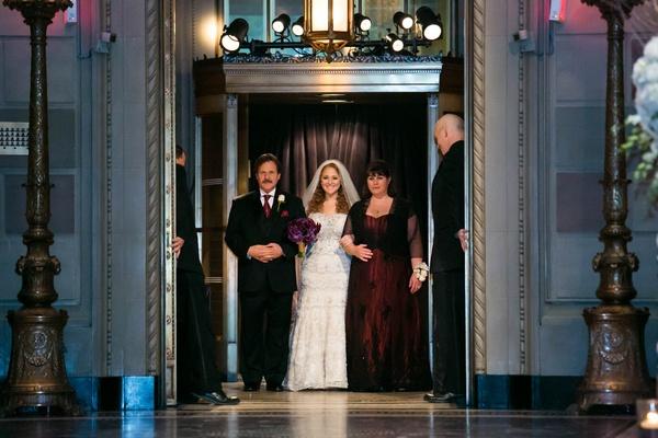 Bride in Kleinfeld Bridal wedding dress with parents in deep purple burgundy wedding attire
