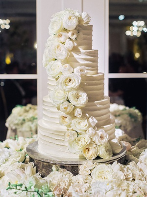 white wedding cake five layer fresh rose flowers and flower cake table