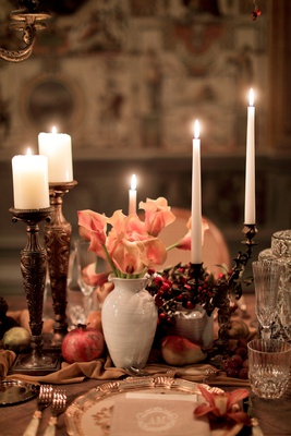 renaissance inspired tablescape in palace in florence, small white vase with peachy calla lilies