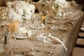 Champagne linens with low floral arrangements