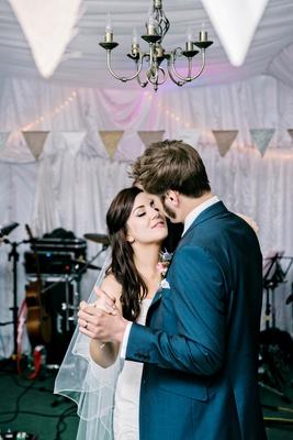 bride and groom dance close wedding reception DIY english british garden wedding blue suit pink